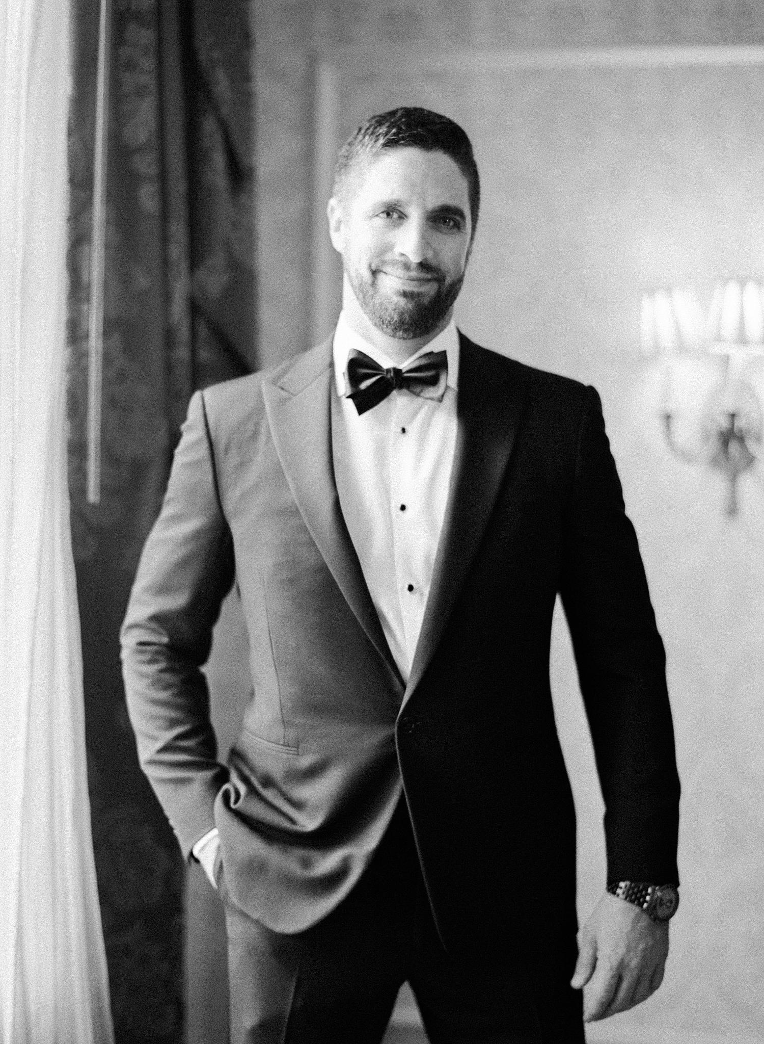 black and white fine art film wedding photographer, groom