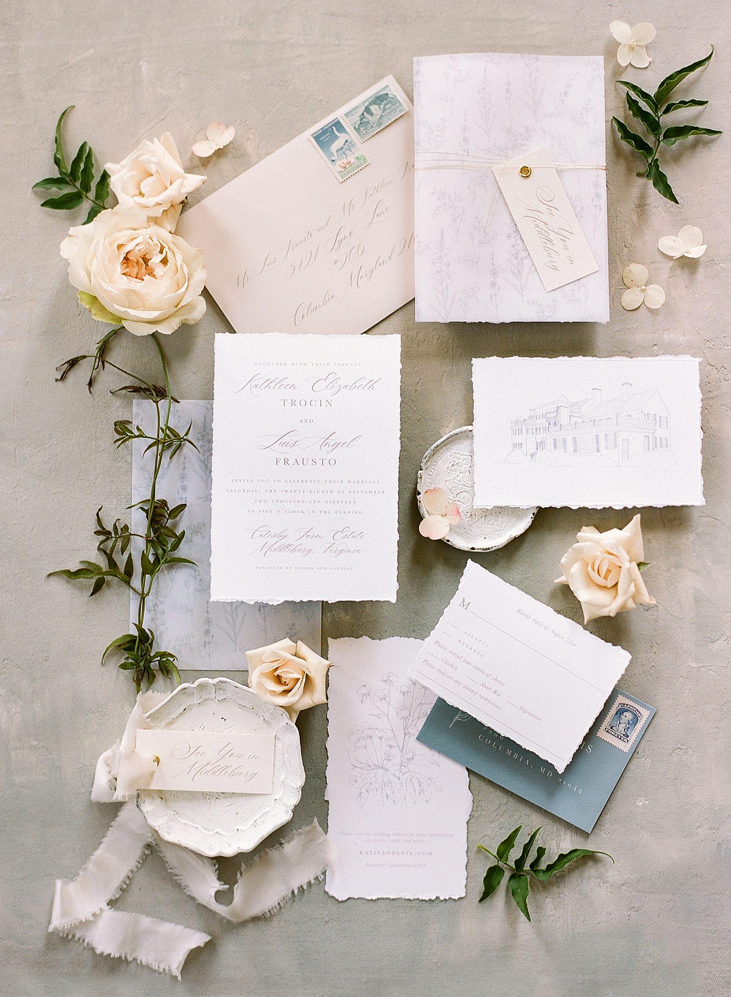 fine art wedding invitation flat lay